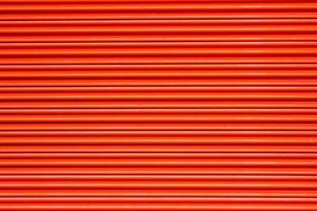 housing lot: Orange metal door