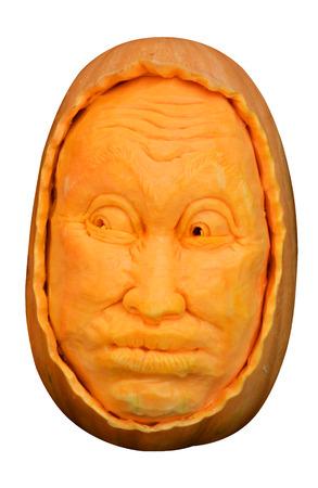 carving pumpkin: Talla de un tallado de calabazas aislados