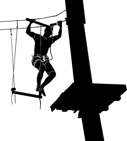 difficult: man on cables in an adventure park on a difficult course. park on a difficult course. Silhouette Adventure. adventure park.