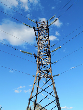 electric wires on a support in a blue sky.