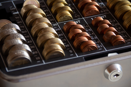 euro coins in a cash box with a lock Stockfoto