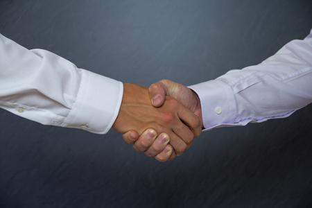 Two businessmen shake hands Stockfoto