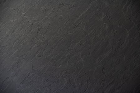Black anthracite background with copy space for text. Gray anthracite texture. Stone texture background. Foto de archivo - 134797892