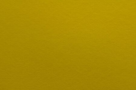 Rough dark yellow paper background with copy space and fine texture