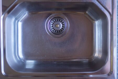 Close up Chrome kitchen sink background with copy space