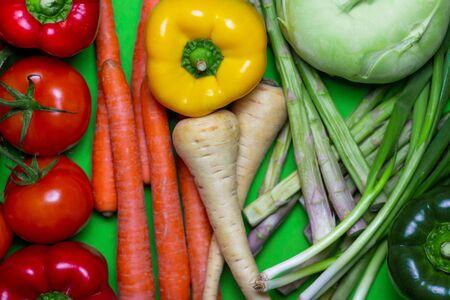 Colorful vegan food spectrum background. Organic and Fresh Vegetables Concept. Food art rainbow. 스톡 콘텐츠
