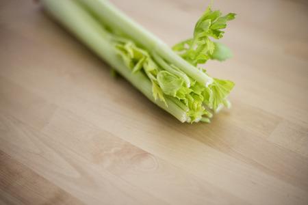 Raw celery on wood table Reklamní fotografie