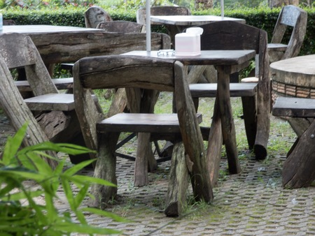 in the open air: wooden chairs thailand open air restaurant Stock Photo