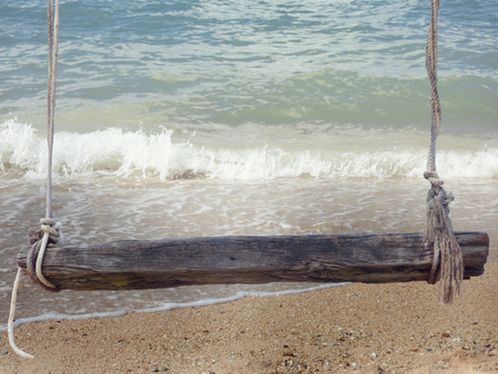 untouched: wooden bench with ropes front of beach background 3d illustration