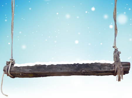 wooden bench: winter wooden bench light blue snowflakes background