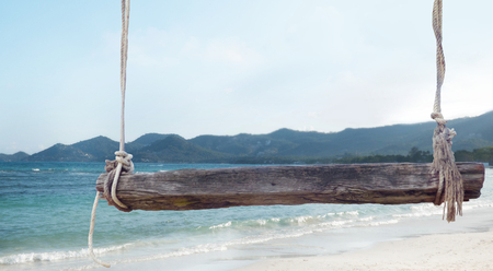 wooden bench: wooden bench with ropes front of beach background 3d illustration
