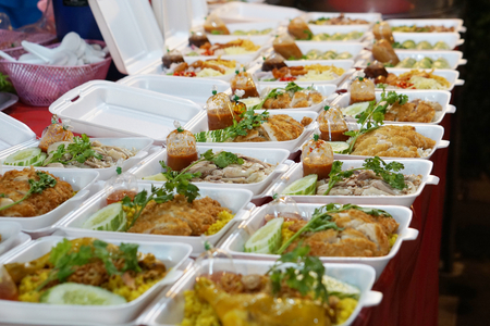 take away food to go at thailand night market with chicken or pork Standard-Bild