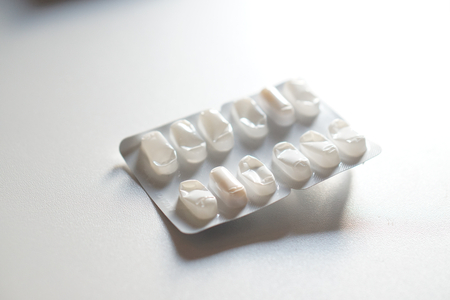 white mostly empty pills package