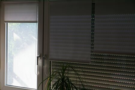 window shutters are down so that the hot sun does not shine in the room