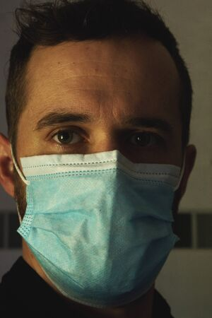 a European German young man, 33 years old, with face mask. Close up face to concept of corona virus and mask