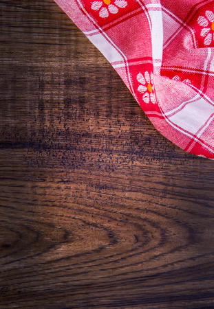 Top view of checkered napkin on empty wooden table photo