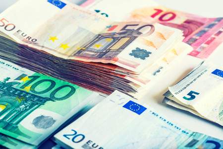 money euro: Several hundred euro  banknotes stacked by value. Euro money concept Stock Photo