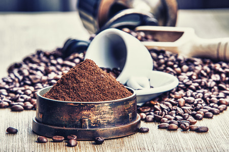 Coffe beans , cup of coffee and grinder Stock Photo