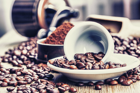 Coffe beans , cup of coffee and grinder 스톡 콘텐츠