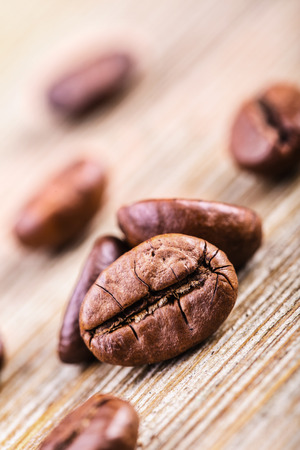 Coffee beans on wooden table photo