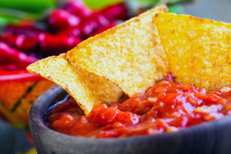 Salsa with tortilla chips and chilli peppers Stock Photo - 40568481