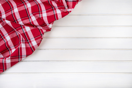 fabric cotton: Top view of checkered kitchen towels on wooden table. Free space for your creative information