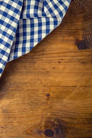 picnic cloth: Top view of checkered napkin on wooden table. Free space for your creative information Stock Photo