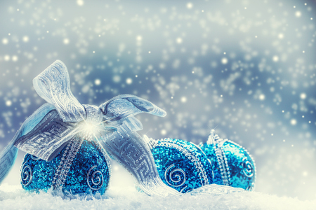 gold ornaments: Christmas.Christmas blue balls and silver ribbon snow and space abstract background.
