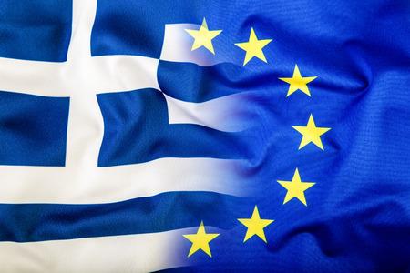 broken unity: European Union and Greece. The concept of relationship between EU and Greece. Waving flag of EU and Greece.