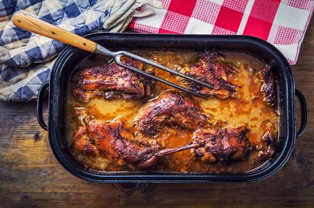 Roast-confit rabbit in wine-mustard sauce and cumin. Domestic rural cuisine.