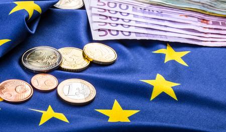 the european economic community: Euro coins. Euro currency. Euro money. European flag and euro money.  Coins and banknotes European currency freely laid on the European flag