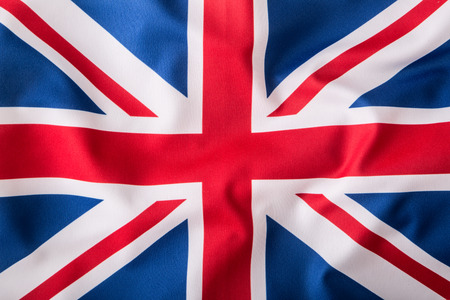 Great: Closeup of Union Jack flag. UK Flag. British Union Jack flag blowing in the wind. Stock Photo