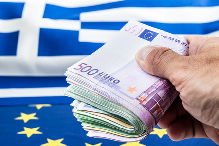 european economic community: Euro coins. Euro currency. Euro money. Greece and european  flag and euro money.  Coins and banknotes European currency freely laid on the European flag