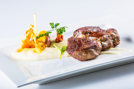 rump steak: Rump steak. Close up Tender Grilled Beef Meat on White Plate with vegetable decoration.