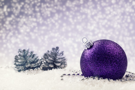 Christmas balls. Luxury Christmas ball with ornaments in Christmas Snowy Landscape. Christmas time. Archivio Fotografico