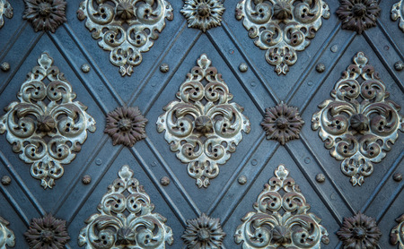 repetitive: Vintage ancient background. Rustic ancient doors pattern medieval repetitive ornaments. Stock Photo