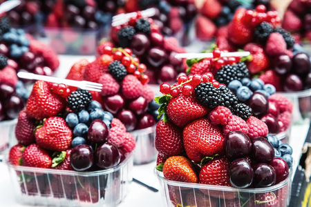 emporium: Berry fruits at a marketplace Blueberries, raspberries, strawberries, cherries Forest fruits. Gardening ,agriculture,harvest and forest concept.