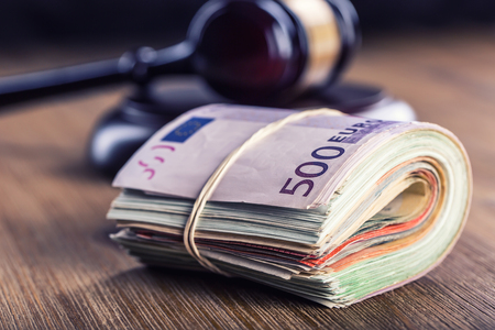 Judges hammer gavel. Justice and euro money. Euro currency. Court gavel and rolled Euro banknotes. Representation of corruption and bribery in the judiciary.