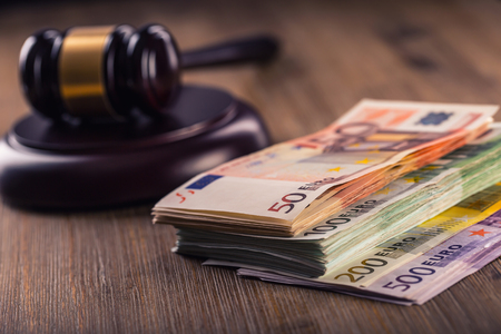 judiciary: Judges hammer gavel. Justice and euro money. Euro currency. Court gavel and rolled Euro banknotes. Representation of corruption and bribery in the judiciary.