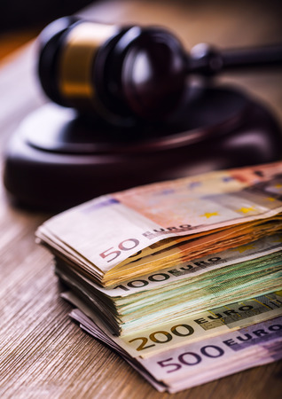 bribery: Judges hammer gavel. Justice and euro money. Euro currency. Court gavel and rolled Euro banknotes. Representation of corruption and bribery in the judiciary.