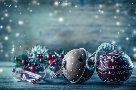 baubles: Christmas Time. Jingle Bells pine branches Christmas decoration in the snow atmosphere. Stock Photo