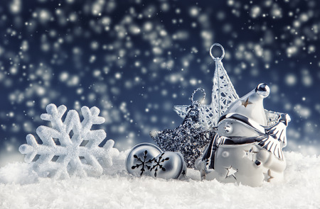 jingle bells: Christmas time. Snowman with christmas decoration and ornaments - jingle bells star snowflakes in snowy atmosphere.