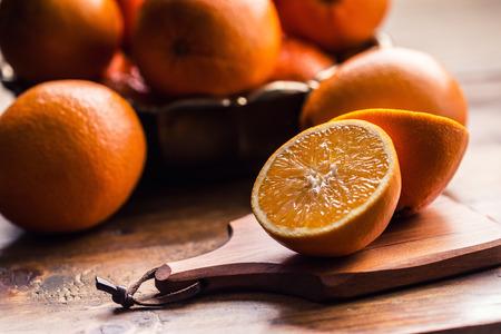 juice squeezer: Fresh oranges. Cut oranges. Pressed orange manual method. Oranges and sliced oranges with juice and squeezer.