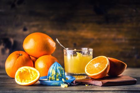 Fresh oranges. Cut oranges. Pressed orange manual method. Oranges and sliced oranges with juice and squeezer.