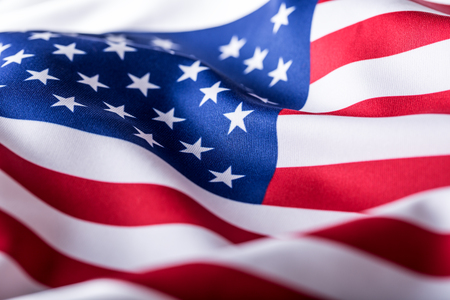 american states: USA flag. American flag. American flag blowing wind. Close-up. Studio shot.