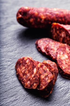 chorizo: Sausage Chorizo. Spanish traditional chorizo sausage, with fresh herbs, garlic, prpper and chili peppers. Traditional cuisine.