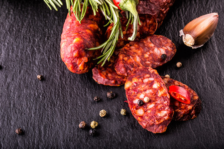 Sausage Chorizo. Spanish traditional chorizo sausage, with fresh herbs, garlic, prpper and chili peppers. Traditional cuisine.
