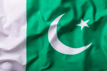 pakistani pakistan: Pakistan flag. Waving colorful Pakistani flag.