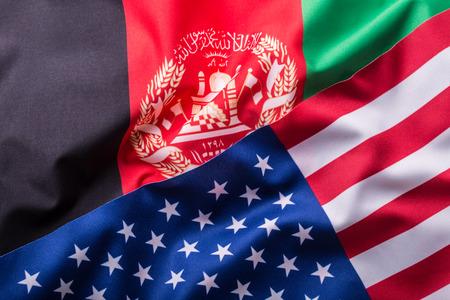 international crisis: USA and Afganistan. Usa flag and afganistan flag.