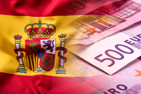 flag of spain: National flag of spain and euro banknote - concept. Euro coins. Euro money. Euro currency